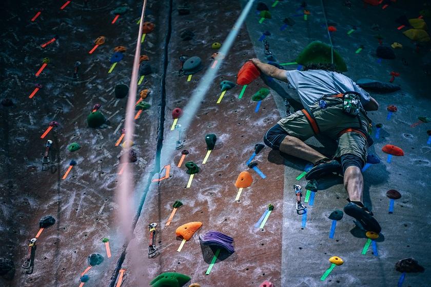 Belay-certified indoor rock climbing