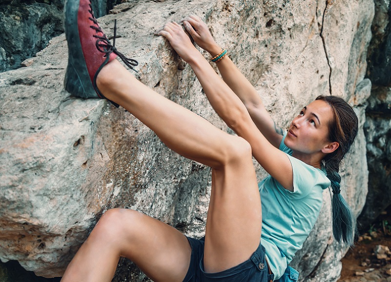 Young woman doing Outdoor bouldering
